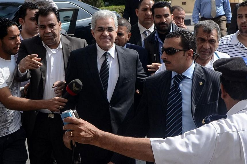 Egyptian leftist leader Hamdeen Sabbahi arrives to submit the documents required to run in next month's presidential election to the High Presidential Elections Committee, on April 19, 2014, in Cairo. Mr Sabbahi on Saturday submitted the documents re