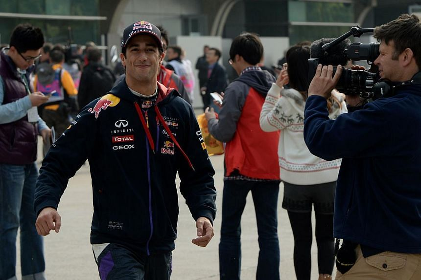 Red Bull driver Daniel Ricciardo of Australia smiles after finishing with the fourth fastest time during the second practice session of the Formula One Chinese Grand Prix in Shanghai, on April 18, 2014. Formula One champions Red Bull were cleared of