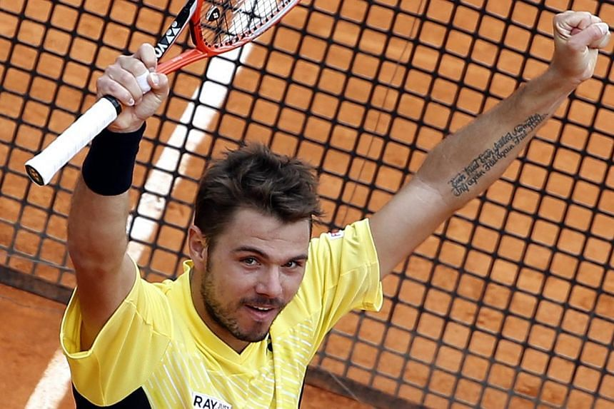 Stanislas Wawrinka of Switzerland celebrates after defeating David Ferrer of Spain during their semi-final match at the Monte Carlo Masters in Monaco, on April 19, 2014.Third seed Wawrinka produced a ruthless display to beat Spain's David Ferre