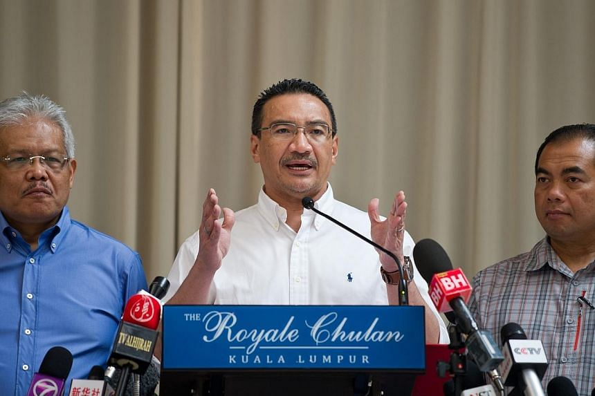 Malaysian Minister of Defence and Acting Transport Minister Hishammuddin Hussein (centre) speaks during a press conference at a hotel in Kuala Lumpur on Saturday, April 19, 2014.The underwater search for black boxes from the missing Malaysia Fl