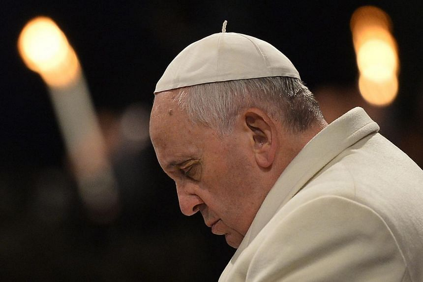 Pope Francis attends the Celebration of the Way of the Cross on Good Friday on April 18, 2014, at the Colosseum in Rome.Pope Francis on Saturday, April 19, 2014, voiced condolences for the victims of a ferry disaster in South Korea, where 273 p