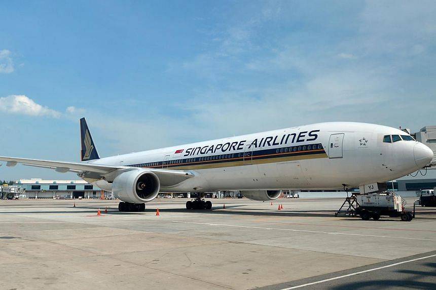 A Singapore Airlines (SIA) flight bound for London had to turn back after cabin crew reported a fault with two of the aircraft's air conditioning units.-- ST FILE PHOTO:ALPHONSUS CHERN