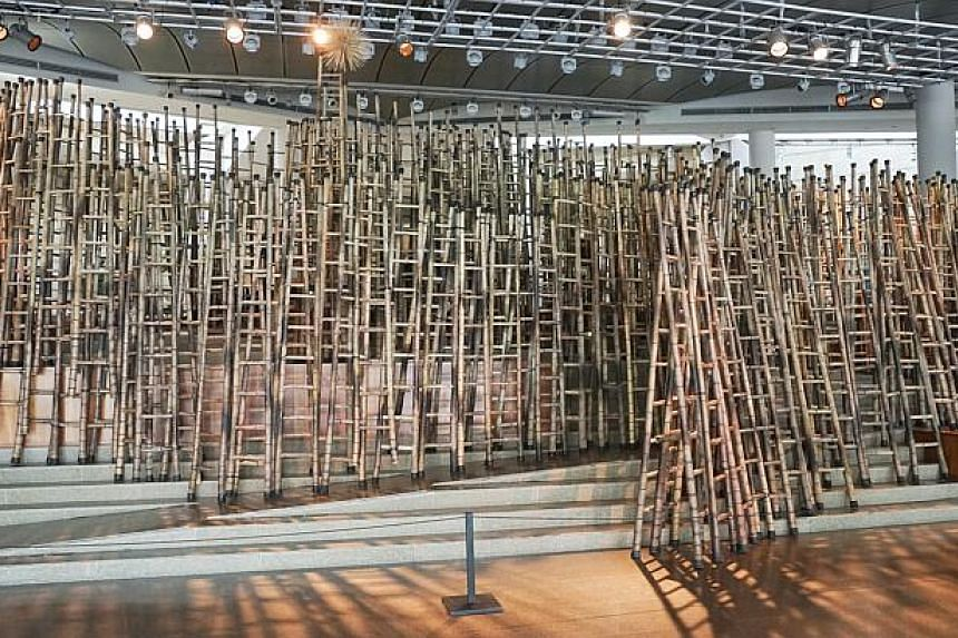 Soaring Dragon by Carl Cheng Chi Ming, an installation using 250 bamboo ladders, is based on the qian chapter of the Book of Changes (Yi Jing), one of the oldest Chinese classic texts and a book of divination and wisdom. The artwork was on display at