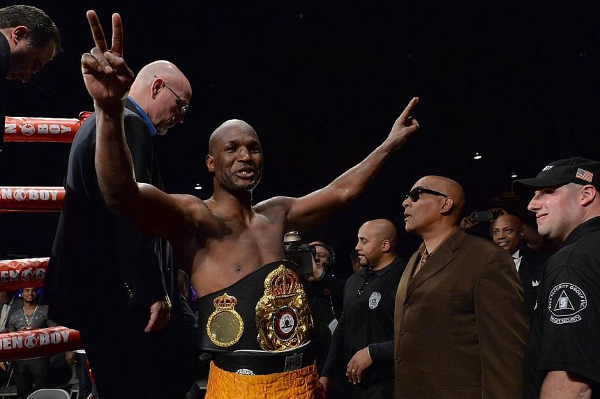 Bernard Hopkinsof the US celebrates victory over Beibut Shumenov of the US following their their WBA & IBA Light-heavyweight title fight at the DC Armory in Washington on April 19, 2014. American Bernard Hopkins became the oldest man to unif