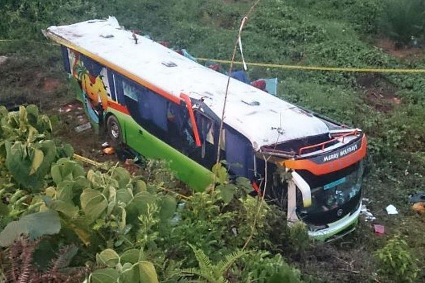 A Singapore-bound tour bus plunged into a ravine off Jalan Kuantan-Segamat, killing one British tourist. -- PHOTO: THE STAR/ASIA NEWS NETWORK
