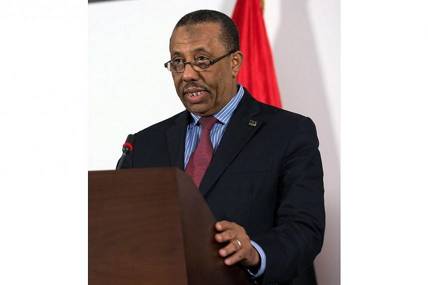 A file picture taken on March 12, 2014 shows Libya's interim premier Abdullah al-Thani speaking during a press conference in Tripoli.The Libyan parliament on Sunday began hearing seven candidates who are vying to replace prime minister Abdullah