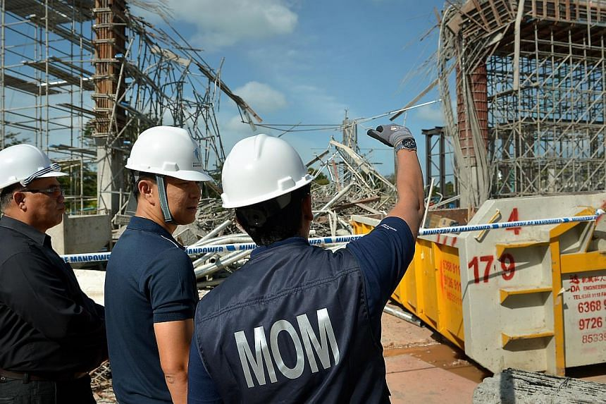 Acting Minister for Manpower Tan Chuan-Jin (centre) visiting the Sentosa worksite where a supporting structure collapsed on Jan 29, 2014, leaving one dead and 10 injured. -- ST FILE PHOTO:KUA CHEE SIONG