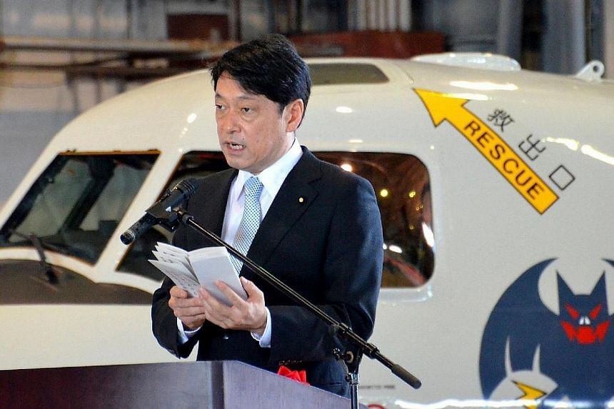 Japan's Defence Minister Itsunori Onodera delivers a speech during a ceremony to launch the squadron of four E-2C early warning planes at an air base of the Self-Defence Forces in Naha, on the southern island of Okinawa Prefecture on April 20, 2014.&