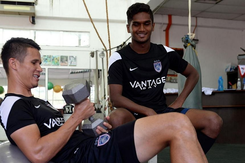 Johor Darul Takzim's (JDT) football players Baihakki Khaizan (left) and Hariss Harun, both from Singapore, working out in the gymnasium at Tan Sri Dato Haji Hassan Yunos Stadium in Larkin, Johor on Jan 23, 2014. SINGAPORE international defender