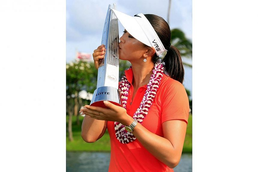 Michelle Wie kisses the trophy on the 18th green after winning the LPGA LOTTE Championship Presented by J Golf on April 19, 2014, in Kapolei, Hawaii.Michelle Wie claimed her first LPGA win on American soil on Saturday, April 19, 2014,comi