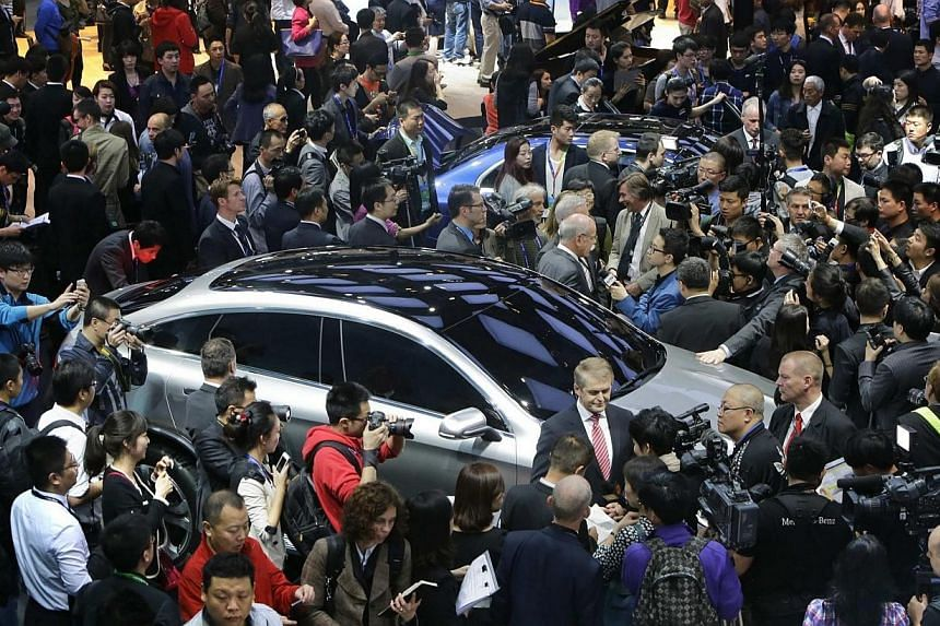 Visitors crowd at the Mercedes Benz's exhibition booth on the first day of Auto China 2014 in Beijing on April 20, 2014. China's desire for luxury cars remains undimmed by an economic slowdown and political austerity drive as the country's growing ba
