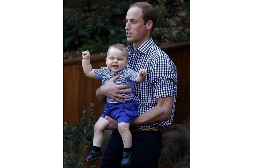 Britain's Prince George reacts in his father Prince William's arms after looking at an Australian animal called a Bilby, which has been named after the young prince, during a visit to Sydney's Taronga Zoo on April 20, 2014. -- PHOTO: REUTERS