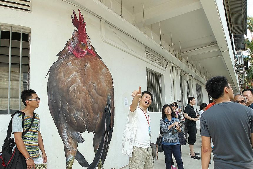 Volunteer guide Choo Lip Sin, 43, taking people on a guided tour of Tiong Bahru estate as part of the Tiong Bahru Heritage Fiesta 2014, which runs until May 7.