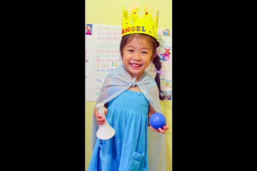 Angel Low in a homemade Queen Elsa outfit created by her mother Summer Goh, who used an existing blue dress and a piece of glittery cloth for the cape. -- PHOTO: SUMMER GOH