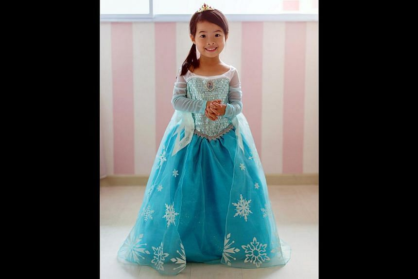 Housewife Ainsley Yip bought a Disney original dress on eBay, which cost US$80, for her daughter Rianne Chew (above). -- PHOTO: COURTESY OF AINSLEY YIP