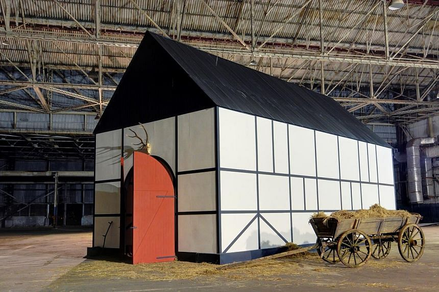 An installation of a German barn at the Singapore Biennale (above) and the Heineken Green Room party both utilised the sprawling space of the former Kallang Airport. -- PHOTO: SINGAPORE ART MUSEUM