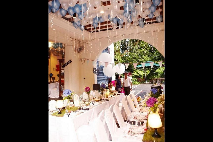 The black-and-white colonial bungalow has been used for private dining events and weddings (above). -- PHOTO: RAINA YONG