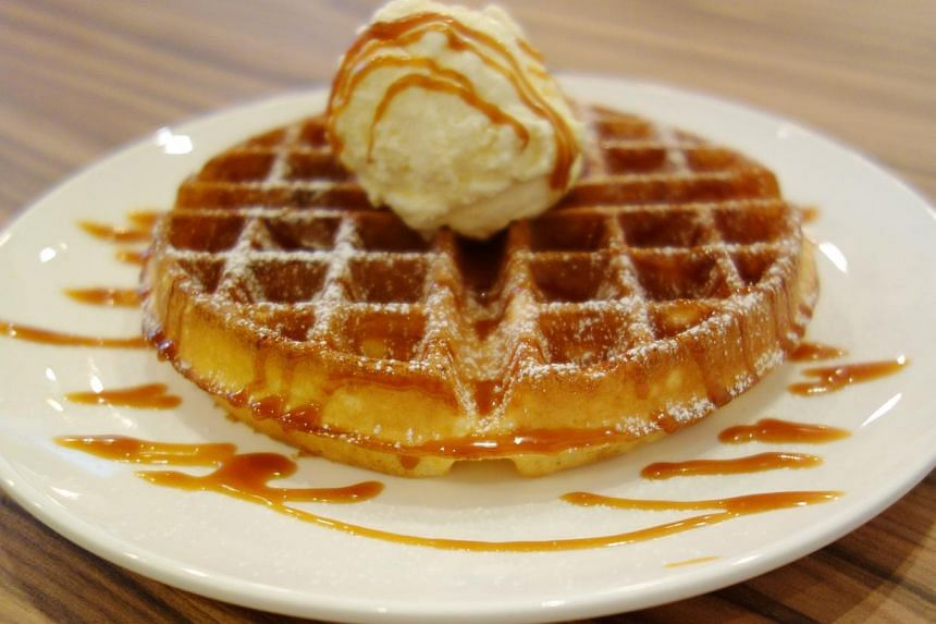 The coffee joint has buttermilk waffles ($11.50 a serving, above) with three toppings. -- PHOTO: ST FILE