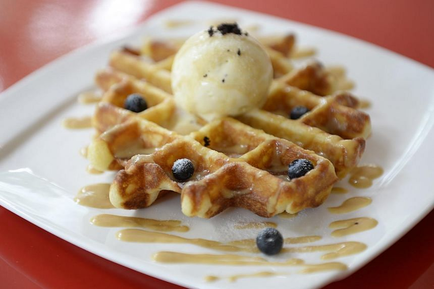 Hatter Street serves a waffle with pandan ice cream and gula melaka sauce (above). -- PHOTO: DESMOND LIM