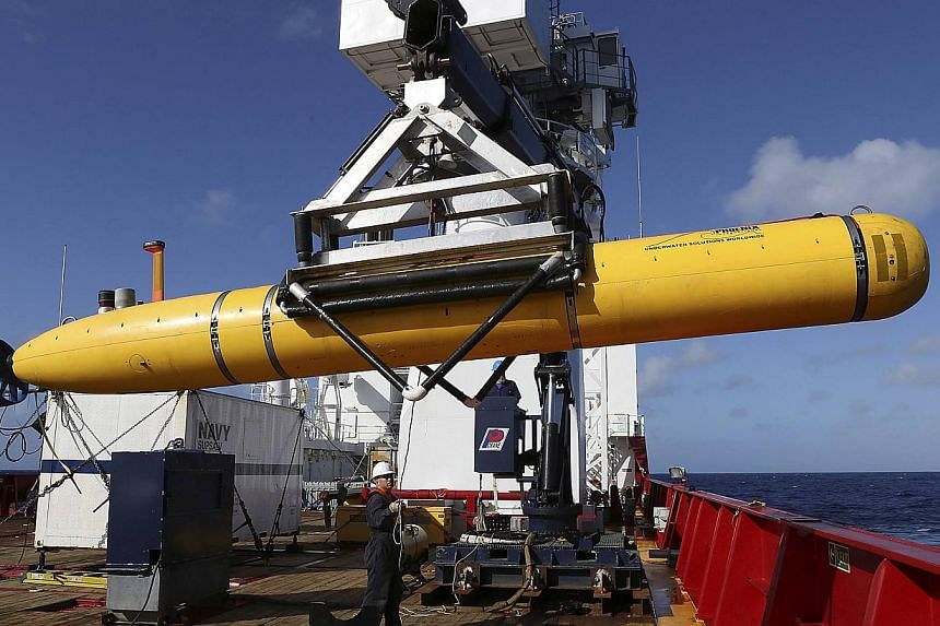 The Phoenix International Autonomous Underwater Vehicle (AUV) Artemis is craned over the side of Australian Defence Vessel Ocean Shield in the search for missing Malaysia Airlines Flight MH370 in the Southern Indian Ocean on April 20, 2014. -- PHOTO: