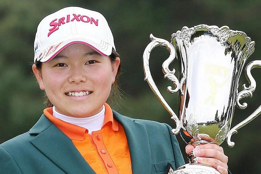 Japanese amateur golfer Minami Katsu holds the trophy during the awarding ceremony of the Vantelin Ladies Open in Kumamoto, western Japan on April 20, 2014. Japanese schoolgirl Minami Katsu became the youngest winner on the country's women's golf tou