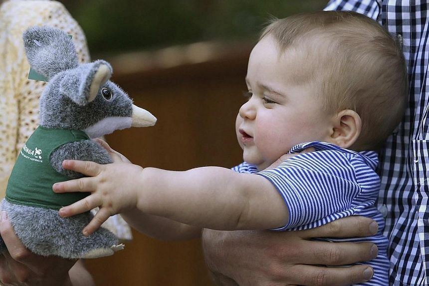 Britain's Prince George holds a toy Bilby during a visit to Taronga Zoo in Sydney, Australia on April 20, 2014. -- PHOTO: REUTERS