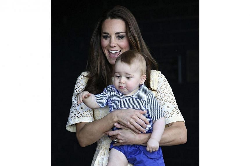 Catherine, Britain's Duchess of Cambridge, holds her son Prince George as they meet a Bilby which has been named after the young prince at Taronga Zoo in Sydney on April 20, 2014. -- PHOTO: REUTERS