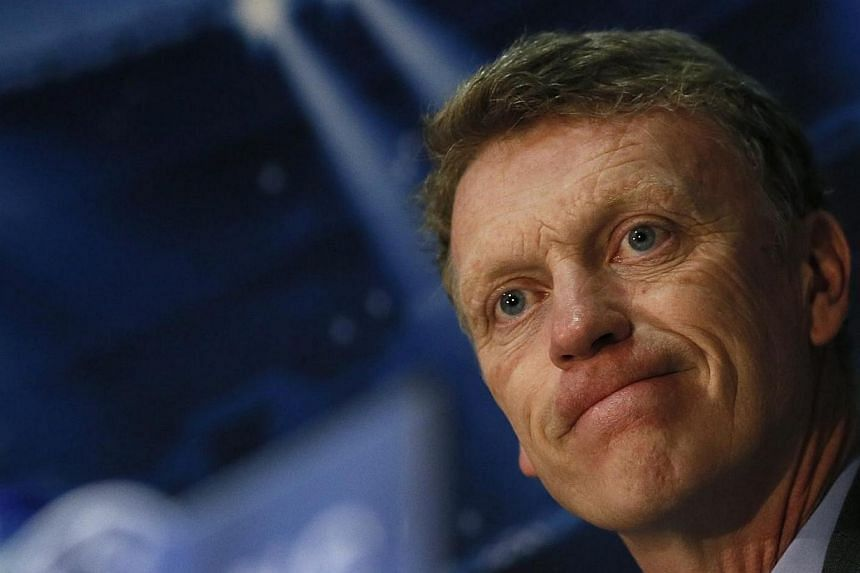 Manchester United's manager David Moyes looks on during a news conference at Old Trafford in Manchester, northern England on March 31, 2014. -- FILE PHOTO: REUTERS