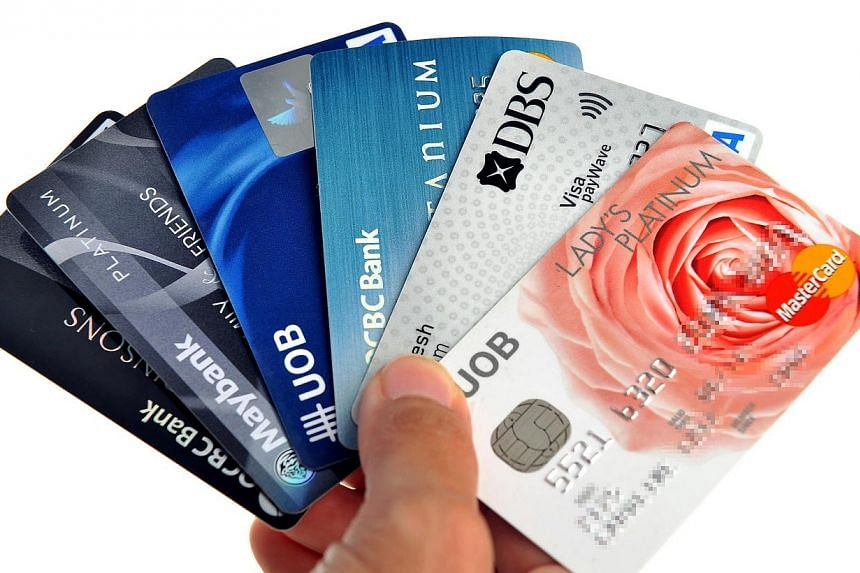 Consumers here long used to signing up for new credit cards are finally resisting the urge to do so.-- ST FILE PHOTO: KUA CHEE SIONG
