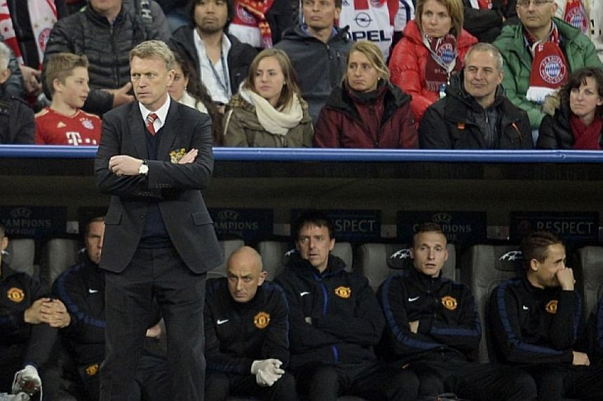 Manchester United's Scottish manager David Moyes reacts during the UEFA Champions League quarter-final second leg football match Bayern Munich vs Manchester United in Munich, southern Germany on April 9, 2014. -- FILE PHOTO: AFP
