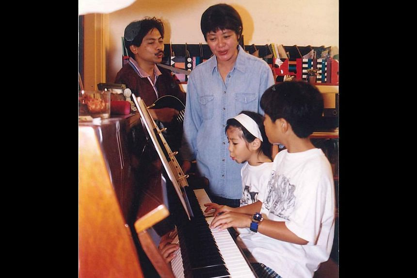 Benjamin Kheng when he was four years old and when he was six with his parents and sister Narelle (above). -- PHOTO: COURTESY OF BENJAMIN KHENG