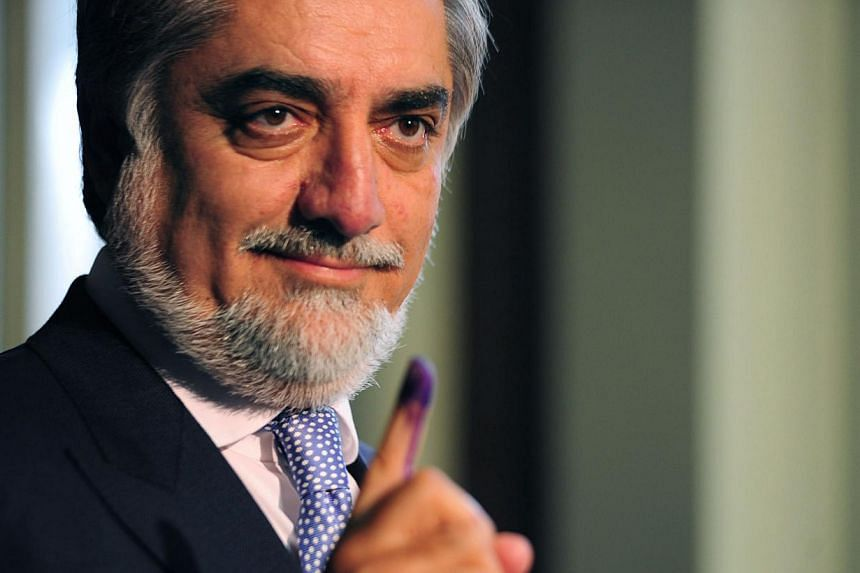 Afghan Presidential candidate Abdullah Abdullah shows his inked finger as he casts his vote at a local polling station in Kabul on April 5, 2014. -- FILE PHOTO: AFP