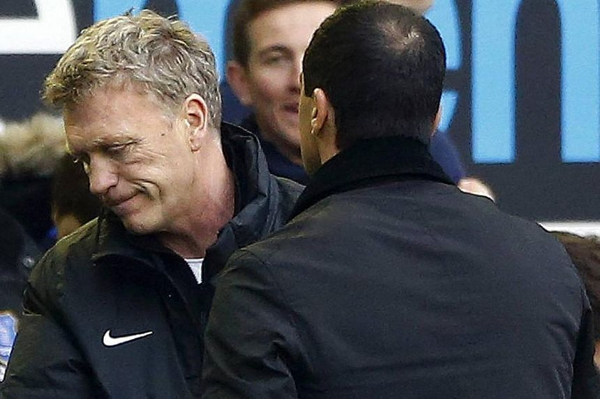 Everton manager Roberto Martínez (right) shakes hands with Manchester United manager David Moyes after their English Premier League match at Goodison Park in Liverpool on April 20, 2014. -- PHOTO: REUTERS
