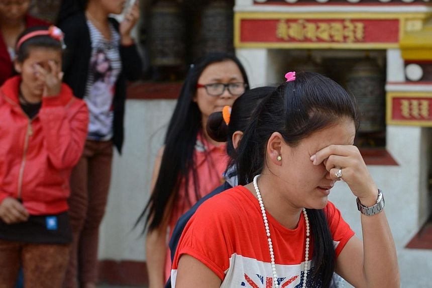 Relatives of a Mount Everest avalanche victim grieve as bodies arrive at the Sherpa Monastery in Kathmandu on April 19, 2014. Nepal's Sherpas have demanded compensation of US$10,000 (S$12,522) for the families of 16 colleagues dead or missing in an a