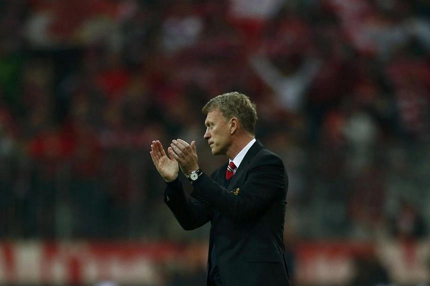 Manchester United's manager David Moyes applauds after their Champions League quarter-final second leg soccer match against Bayern Munich in Munich on April 9, 2014.British reports are saying that Manchester United manager David Moyes is facing