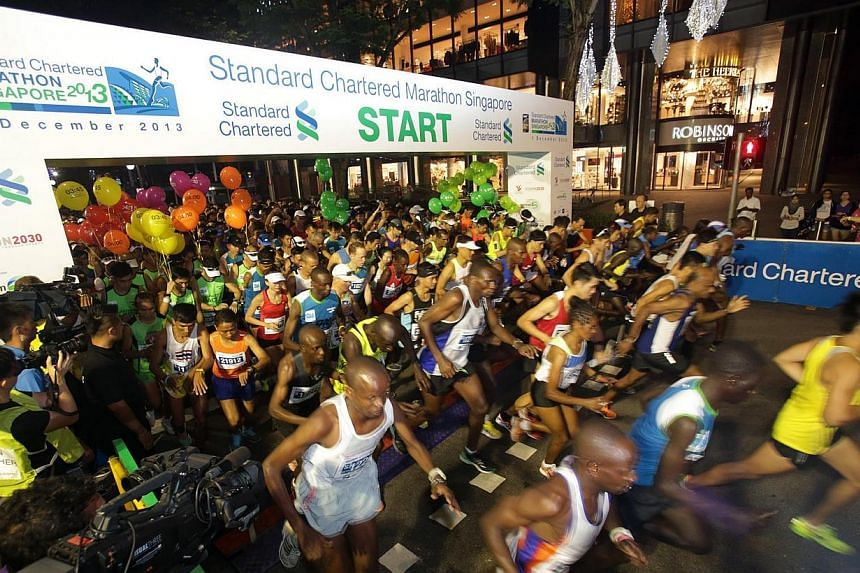The flag-off at Orchard Road for the 42.195km full marathon during the Standard Chartered Marathon Singapore (SCMS) on Dec 1,2013.Singapore's marquee running event will continue to run under Standard Chartered's banner, after the bank ann