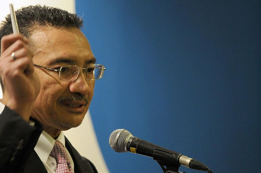 Malaysian Minister of Defence and Acting Transport Minister Hishammuddin Hussein answers questions from journalists during a press conference on the missing Malaysia Airlines flight MH370 on April 15, 2014. Mr Hishammuddin wants a report by April 23,