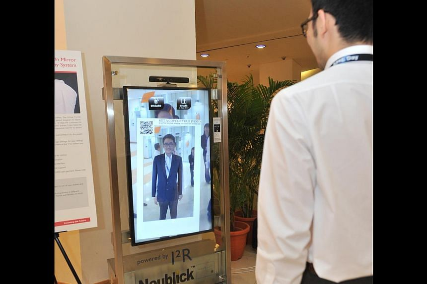 """A """"virtual mirror"""" developed by A*Star at the agency's inaugural SME Day onApril 21, 2014. The """"virtual mirror"""" will allow shoppers to""""try on"""" clothes. -- PHOTO: A*STAR"""