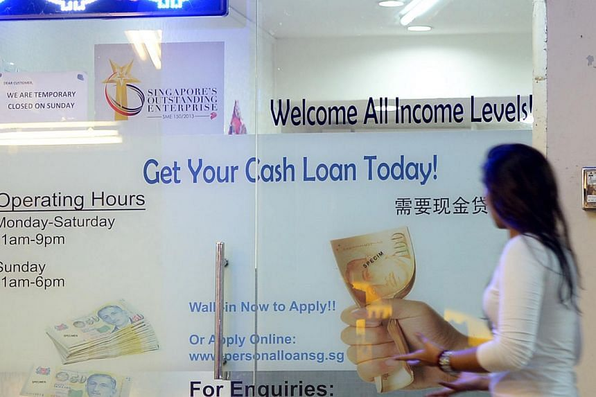 Licensed moneylenders face the prospects of tighter lending rules from late 2015. -- ST FILE PHOTO: DESMOND WEE