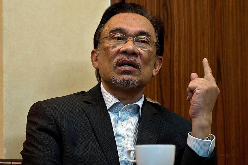 "Malaysia's opposition leader Anwar Ibrahim said Monday, April 21, 2014, a meeting with US President Barack Obama during a coming visit to Malaysia would have been ""consistent with US democratic ideals,"" after Washington said there would be no such en"