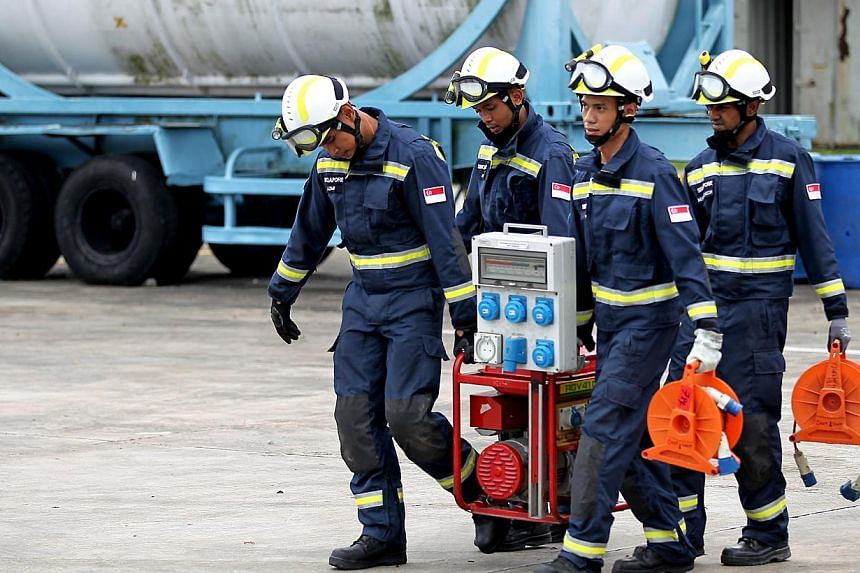 Officers from the Singapore Civil Defence Force (SCDF) with a Hazmat (hazardous materials) Detector unit during Operation Lionheart. Doing more and responding faster, without needing extra manpower - that is the theme behind the new technologies unve