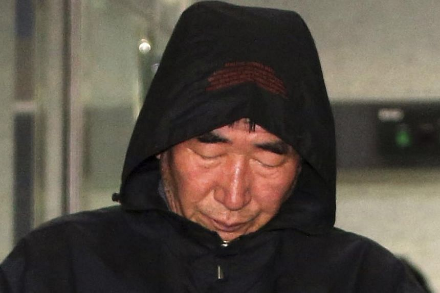Lee Joon-Seok, captain of South Korean ferry Sewol, walks out of court after an investigation in Mokpo on April 19, 2014. -- FILE PHOTO: REUTERS