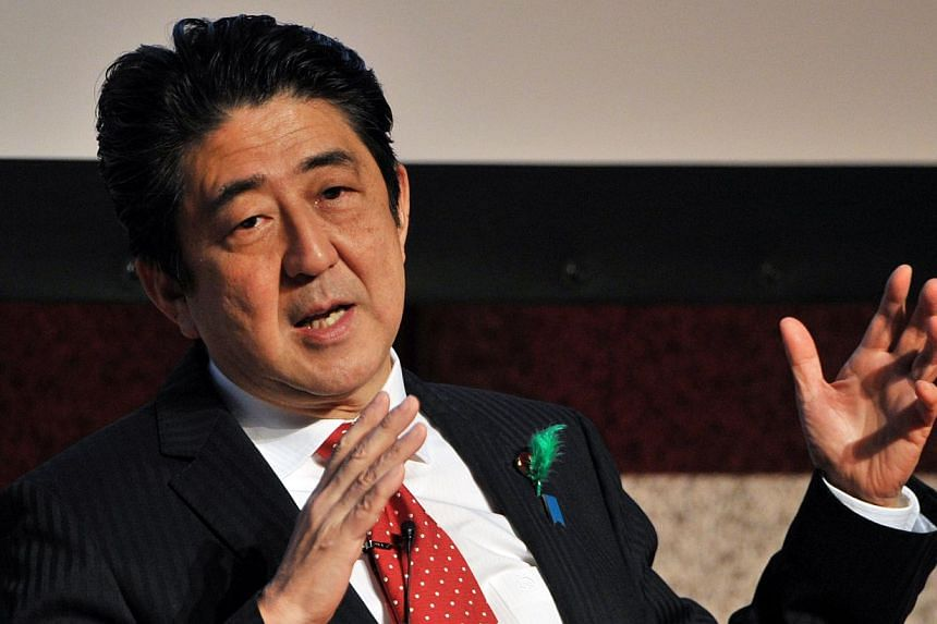 Japanese Prime Minister Shinzo Abe delivers a speech at a forum in Tokyo on April on April 17, 2014. Mr Abe donated a tree to the controversial Yasukuni war shrine on April 21, 2014, but did not visit the memorial which is seen by China and South Kor