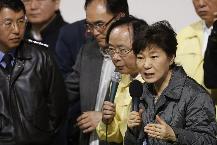 South Korean President Park Geun Hye speaks to family members of missing passengers who were on South Korean ferry Sewol during her visit to a gym where family members gathered, in Jindo on April 17, 2014. -- FILE PHOTO: REUTERS