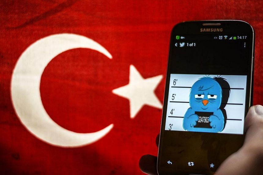 A picture representing a mugshot of the twitter bird seen on a smart phone with a Turkish flag in Istanbul. Two anonymous Twitter accounts used to release secretly recorded conversations implicating family and associates of Turkey's Prime Minister an