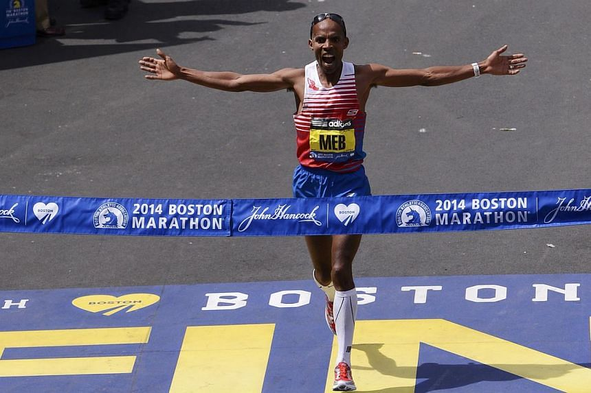 Meb Keflezighi of the US reacts as he wins the men's division at the 118th running of the Boston Marathon in Boston, Massachusetts on April 21, 2014. -- PHOTO: REUTERS