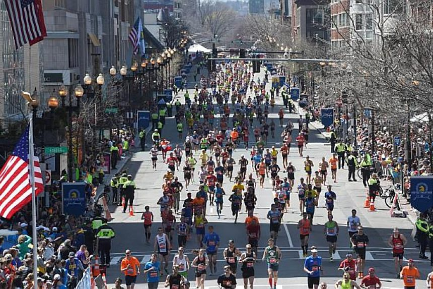 Runners make their way to the finish line during the 118th Boston Marathon in Boston, Massachusetts on April 21, 2014. -- PHOTO: AFP