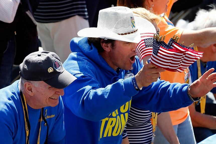 First responder Carlos Arredondo cheers on finishers of the 118th Boston Marathon on April 21, 2014 in Boston, Massachusetts. -- PHOTO: AFP