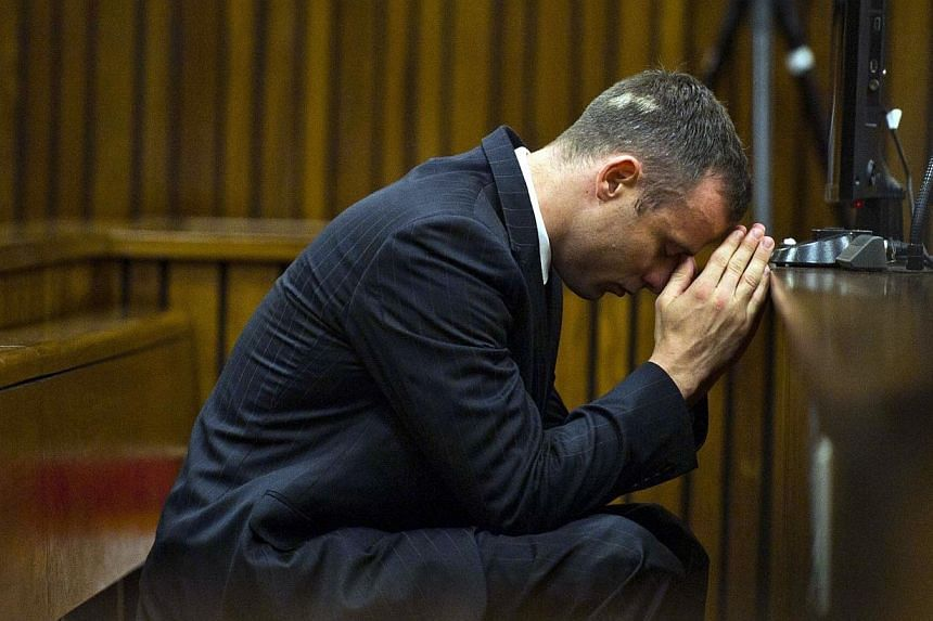 South African Paralympian Oscar Pistorius is seen in the dock on April 17, 2014 at the North Guteng High Court in Pretoria. A spokeswoman for Oscar Pistorius on Tuesday said suggestions that the Paralympian had taken acting lessons ahead of his