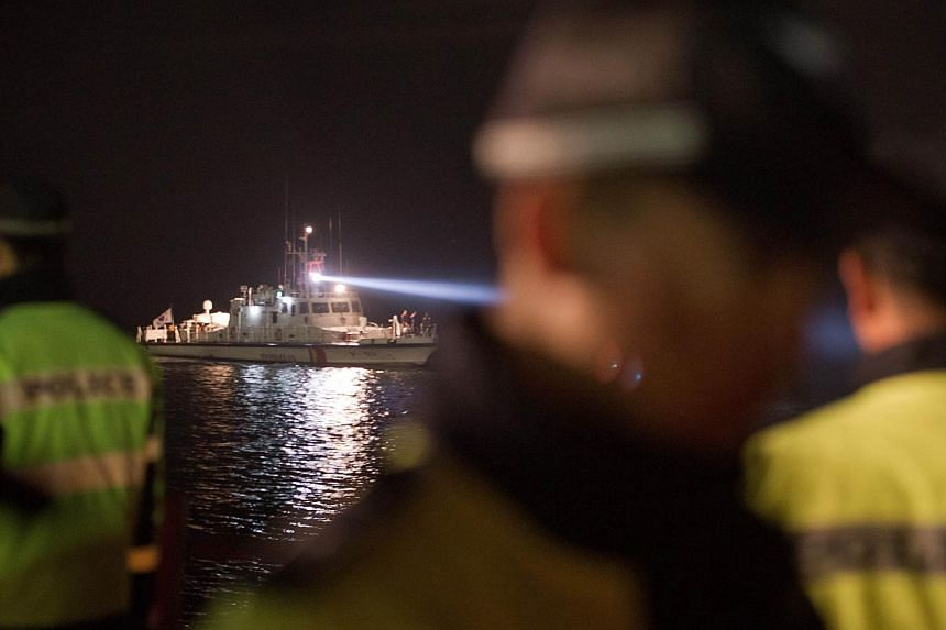 A South Korean coastguard boat returns from the accident site with relatives of victims who were on board the capsized South Korean ferry Sewol at Jindo harbour on April 21, 2014.The United States is sending a Navy salvage ship to help So